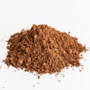 heaping pile of cocoa powder on a white surface