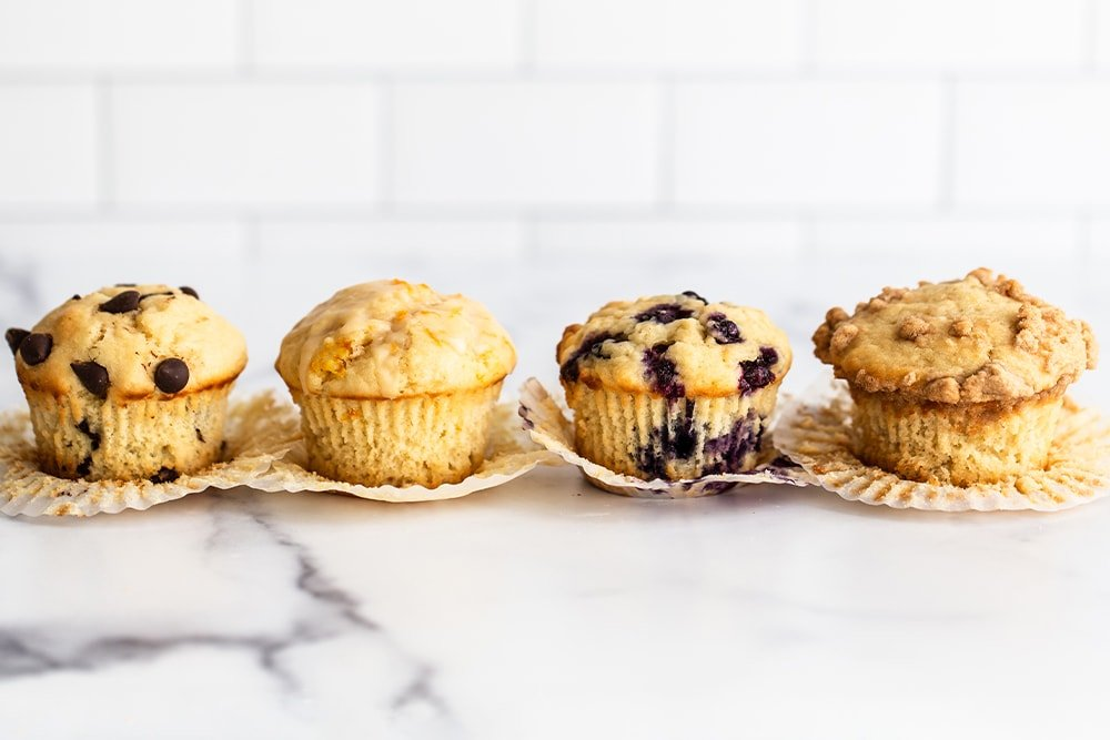 ultimate muffins in liners on a white marble surface