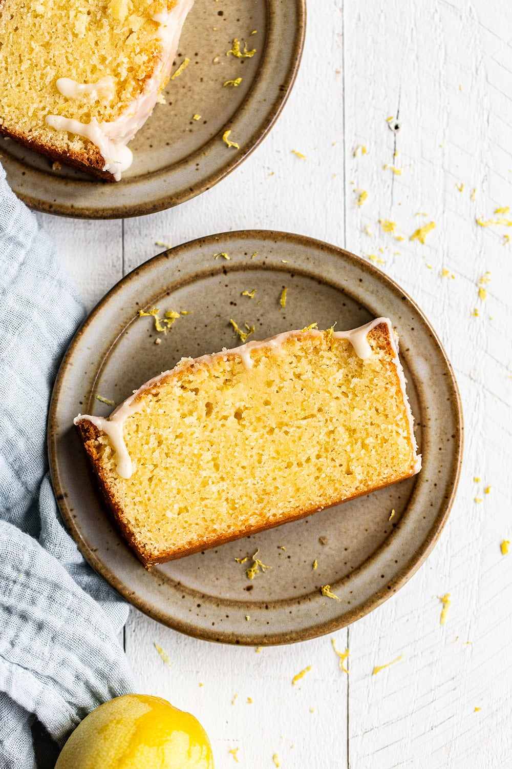 slice of buttery and moist iced lemon pound cake loaf