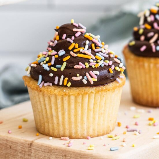light, fluffy and moist yellow cupcakes with chocolate frosting and sprinkles