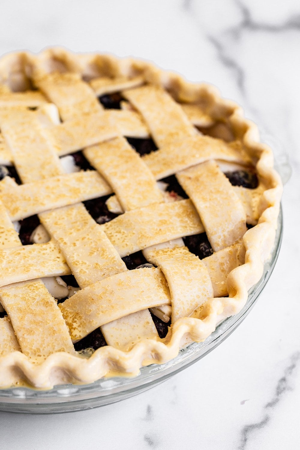 photo showing a beautiful homemade pie with from scratch lattice pie crust