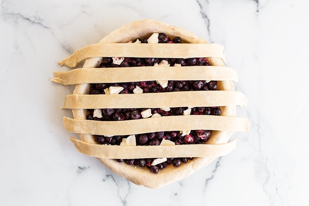 strips of pie dough on top of a pie