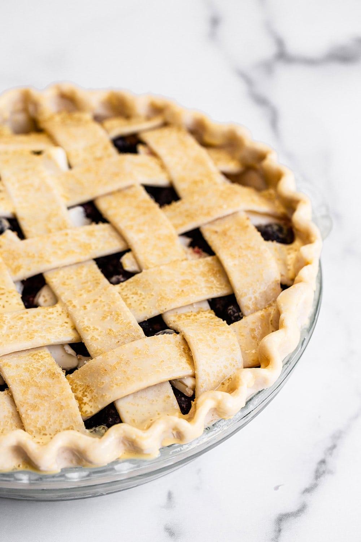 homemade blueberry pie with a lattice pie crust
