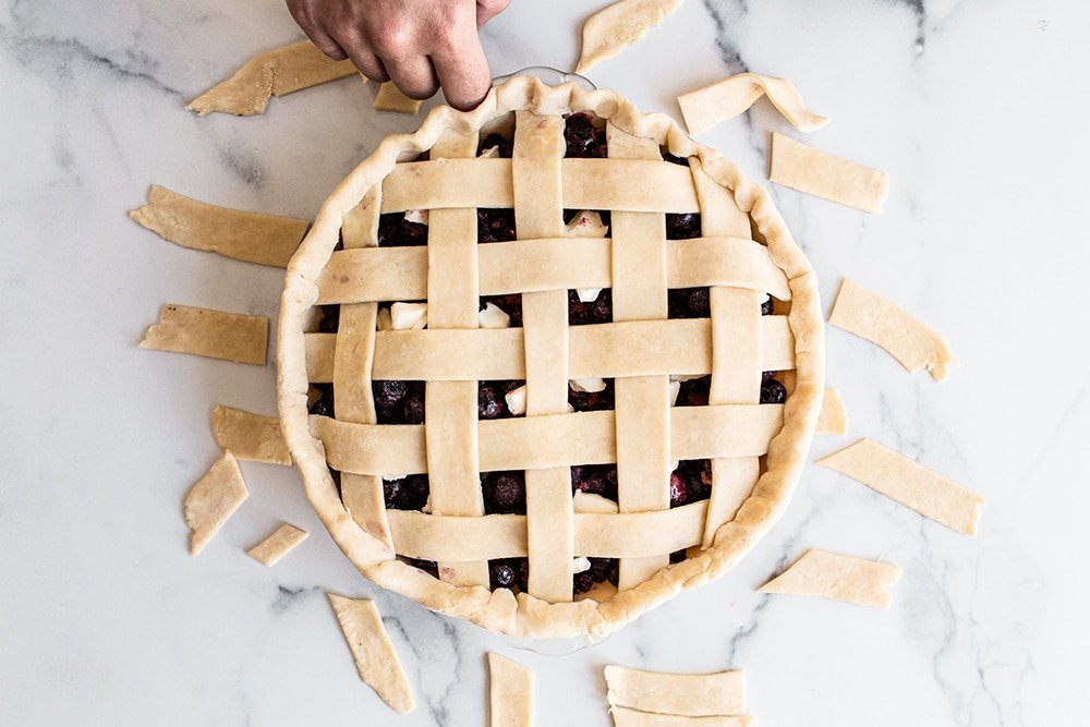 Use your thumb and forefinger on one hand along with the forefinger knuckle of your opposite hand to make a crimping pattern on your homemade pie crust