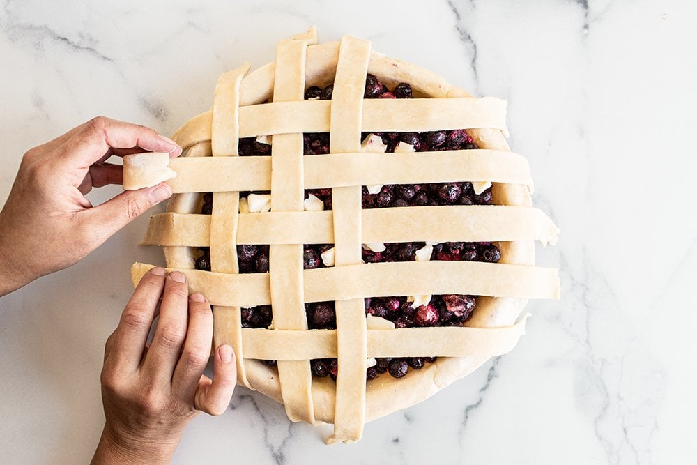 half of the pie strips added to the lattice pie crust