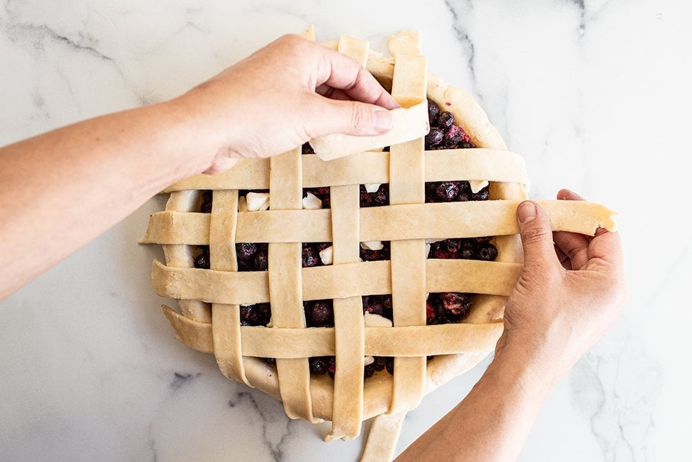 after finishing one side of the pie, begin to place more strips to the other side of the pie