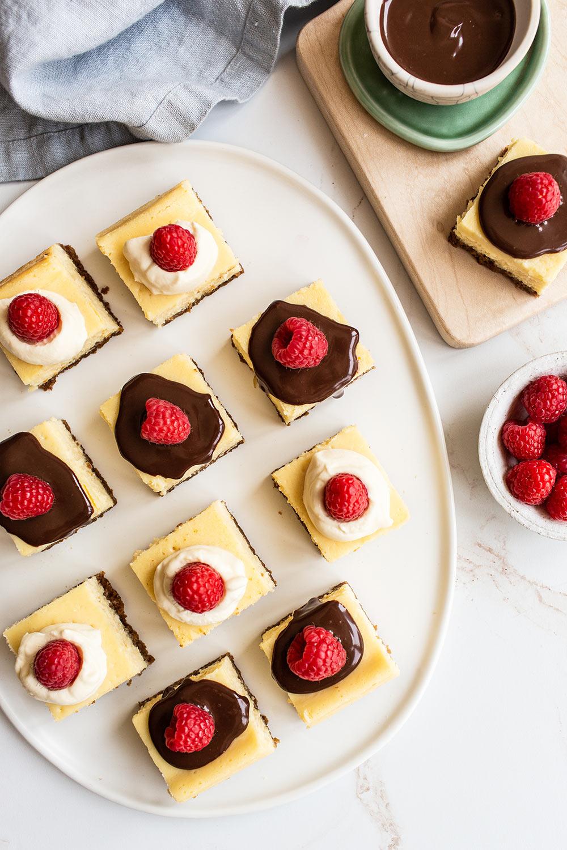 Cheesecake Bars With Chocolate and Raspberries