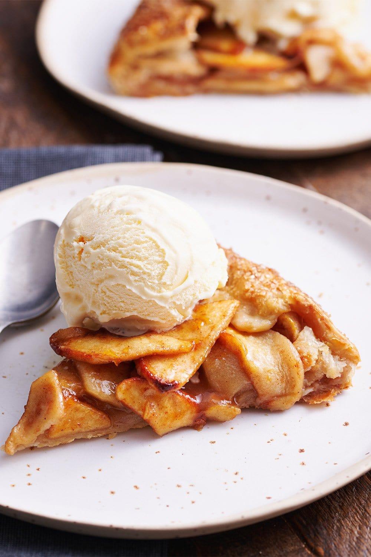 slice of homemade apple tart with a scoop of vanilla ice cream on top
