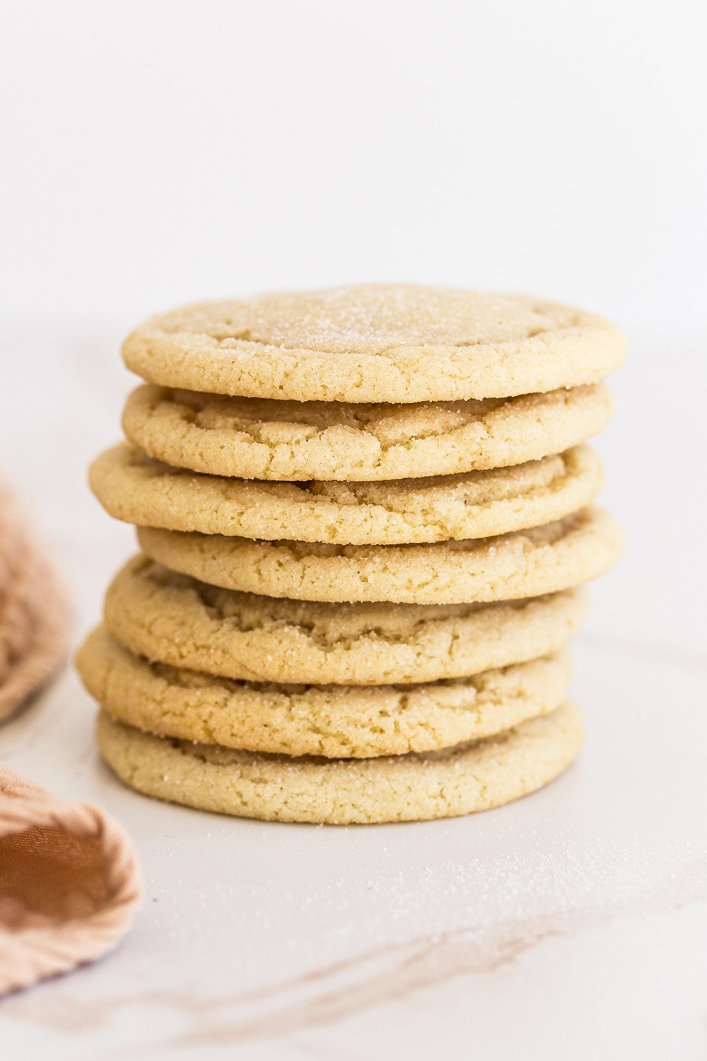 the best drop style sugar cookies stacked on top of each other