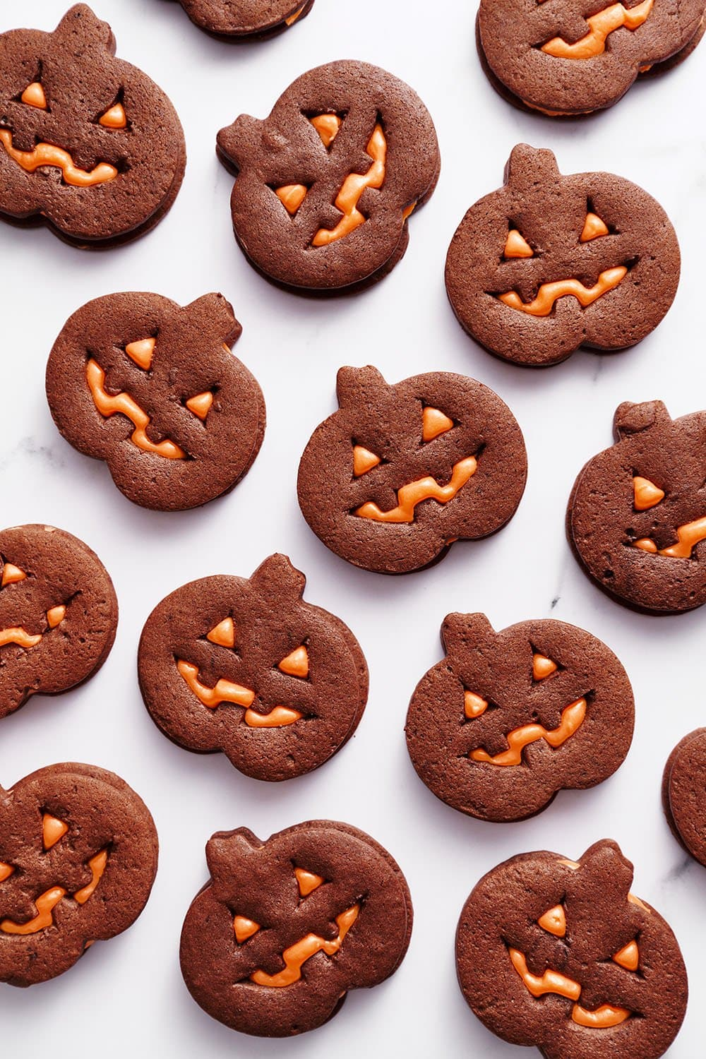 homemade jack o lantern cookies with orange cream cheese frosting for halloween