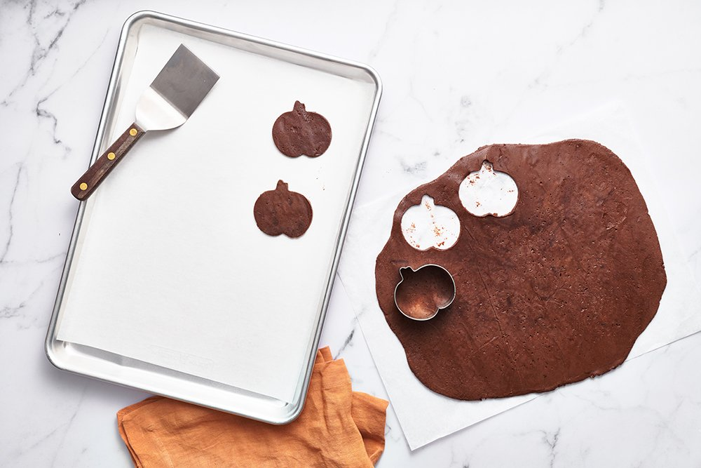 how to cut out jack o lantern shapes from chocolate cookie dough