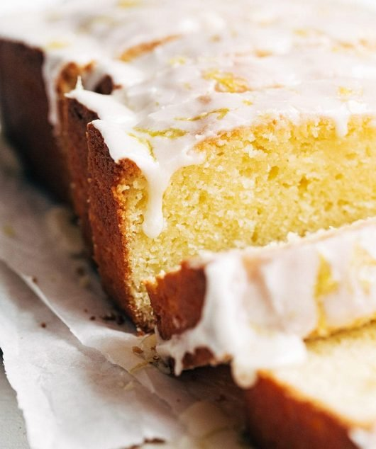 close up of copycat starbucks lemon loaf with icing dripping
